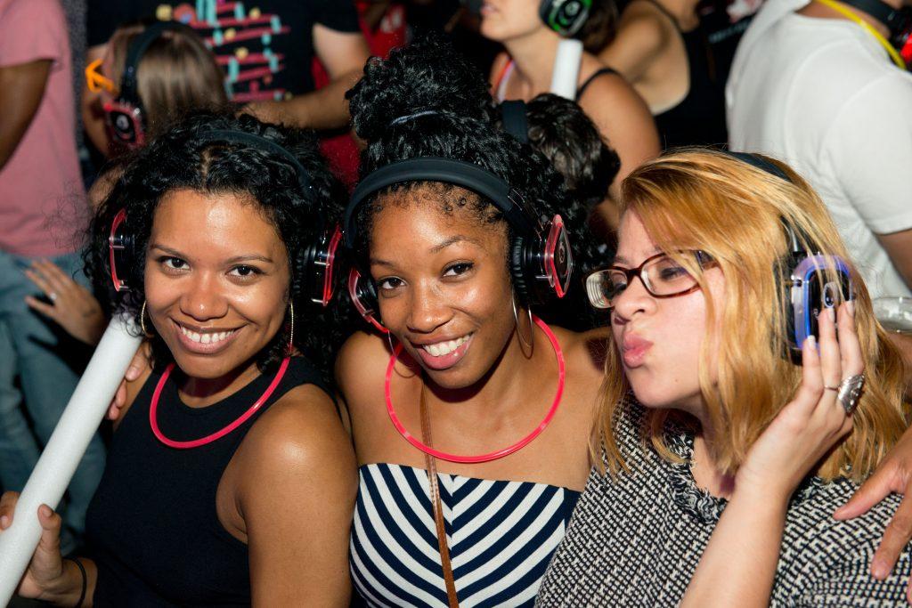 Three ladies enjoying the vibe with headphones