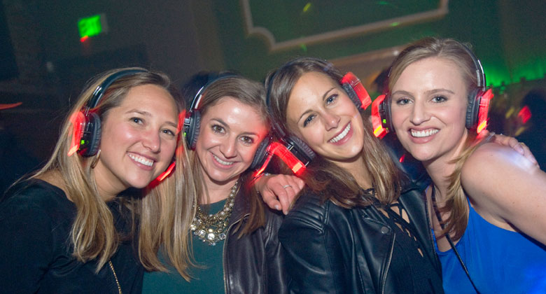 Four girls in silent disco with headphones