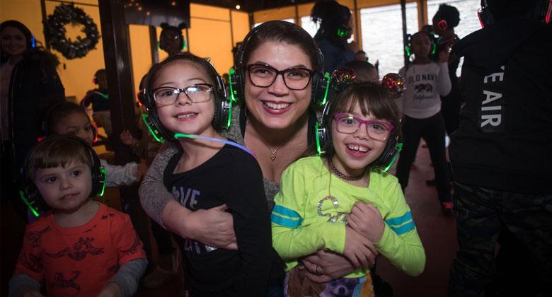 Kids enjoying silent disco with headphones
