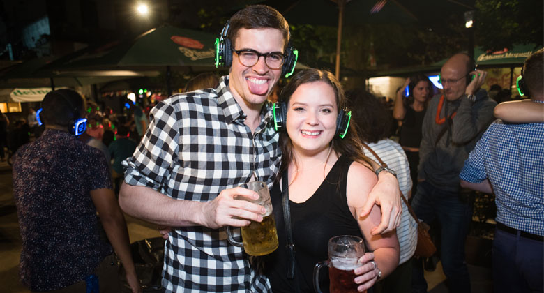 Couple with beer in outdoor silent party