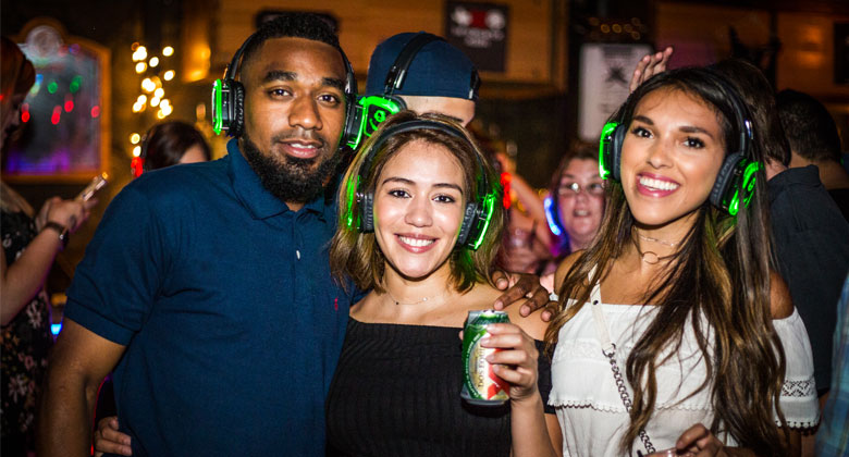Best friends enjoying the party with headphones