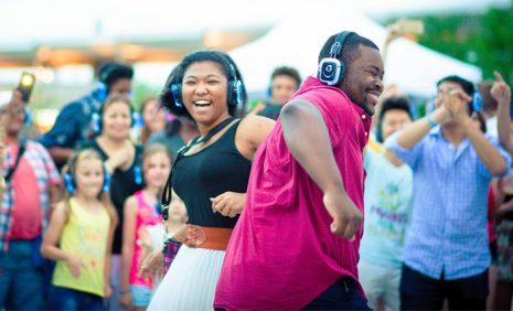 Dancing couple with headphones