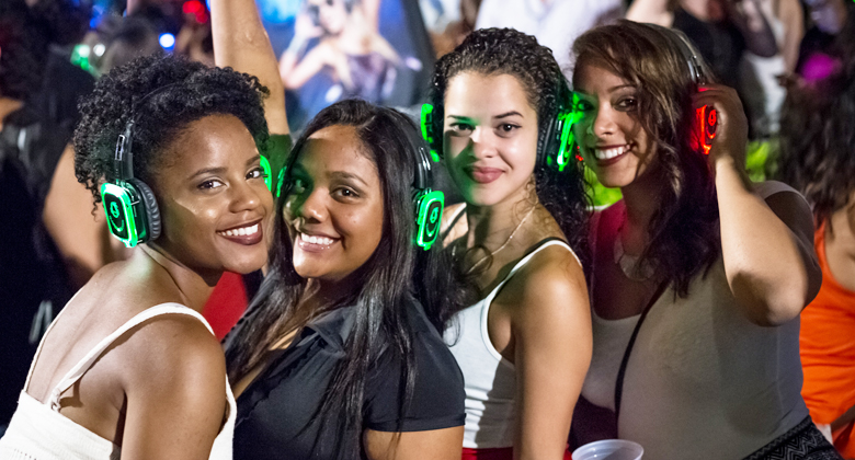 Four girls enjoying the party with headphones