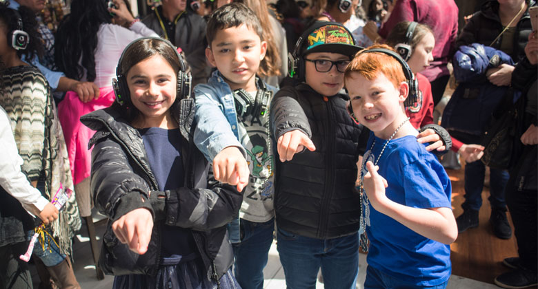 Kids in outdoor silent disco with headphones