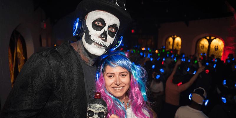 Two people wearing halloween costumes