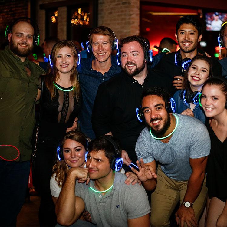 Group of people wearing silent disco headphones