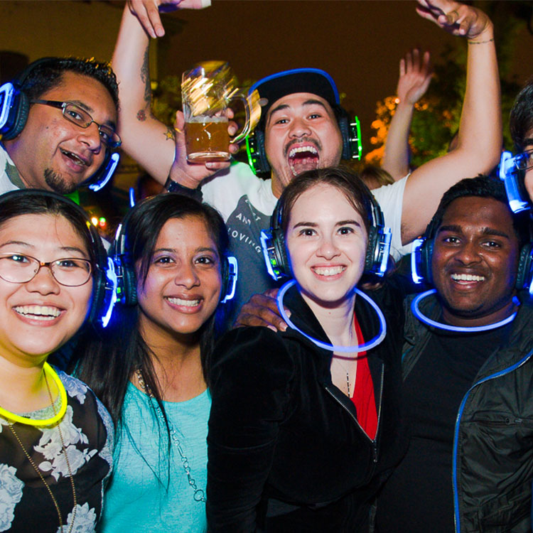 Party people with glow necklaces